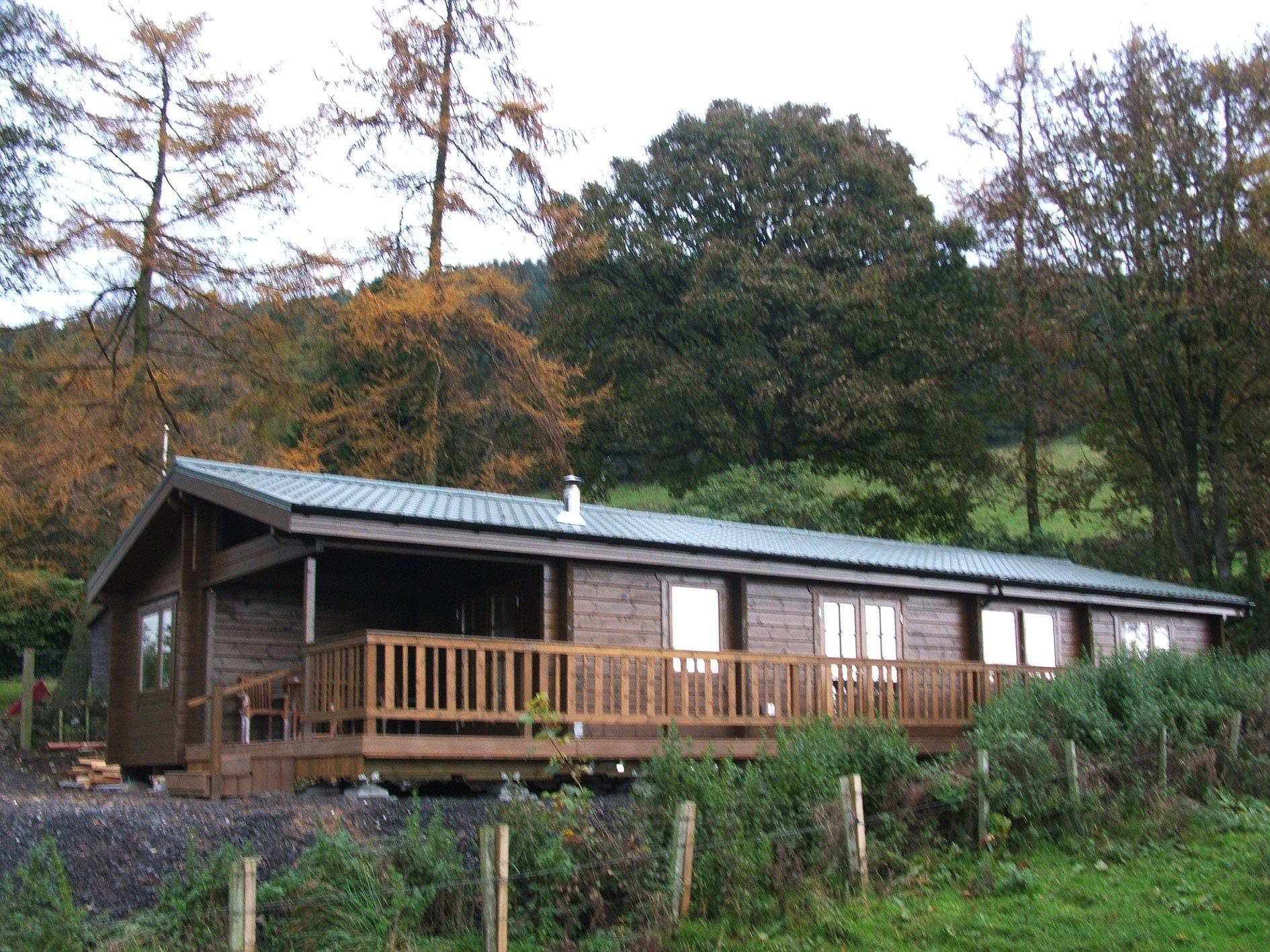 Log cabin in the hillside