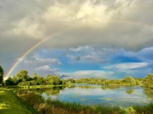 Rainbow over lake at Frisby Lakes