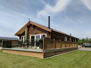Darker Log cabin with decking