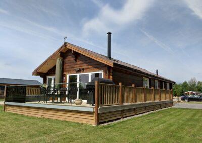 Darker Log cabin with decking