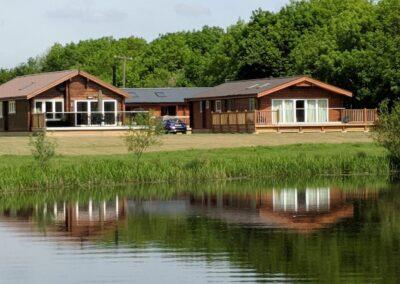 Log Cabins by a lake