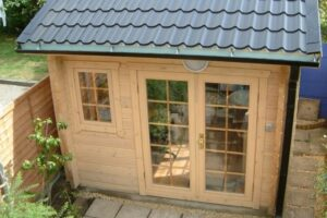 Outside view of a small log cabin office