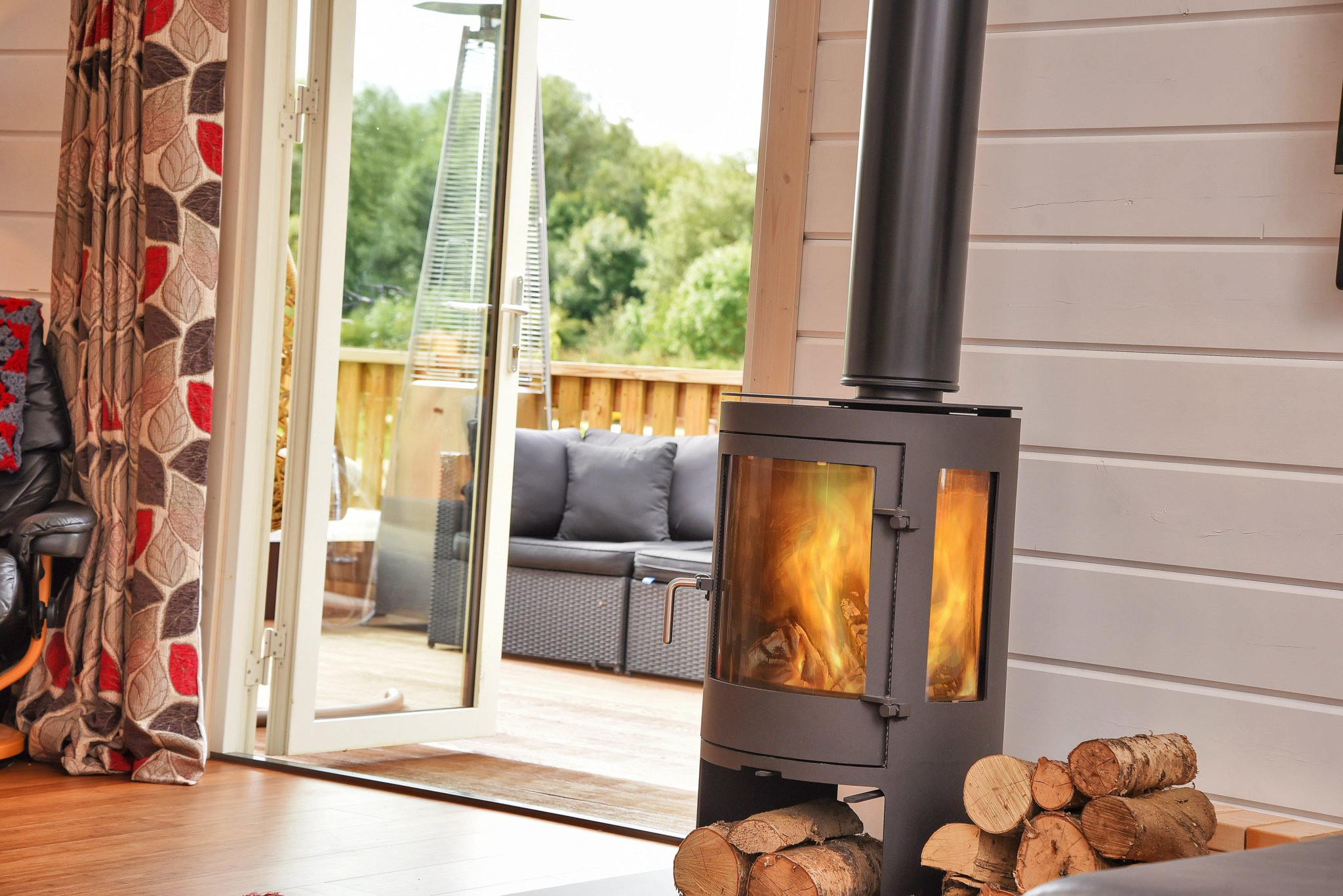Log burner in log cabin